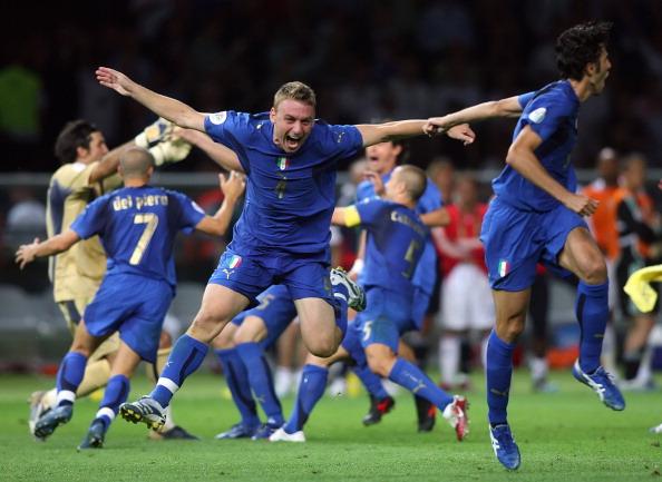 Italian players run to jubilate after wi